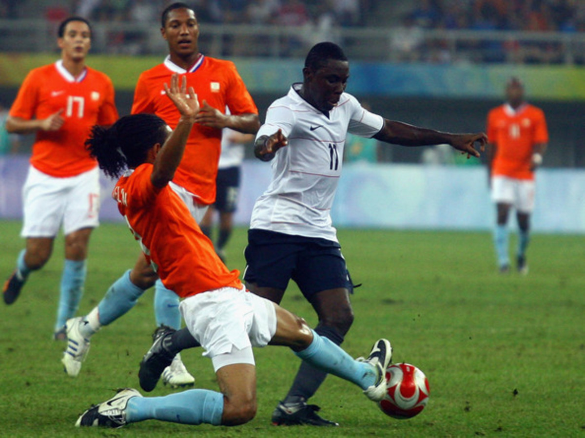 Freddie Adu of the United States competes for the ball with the Netherlands' Urby Emanuelseon during a group stage match in Tianjin, China. The Netherlands and the United States played to a 2-2 draw, a result that proved costly for the United States.