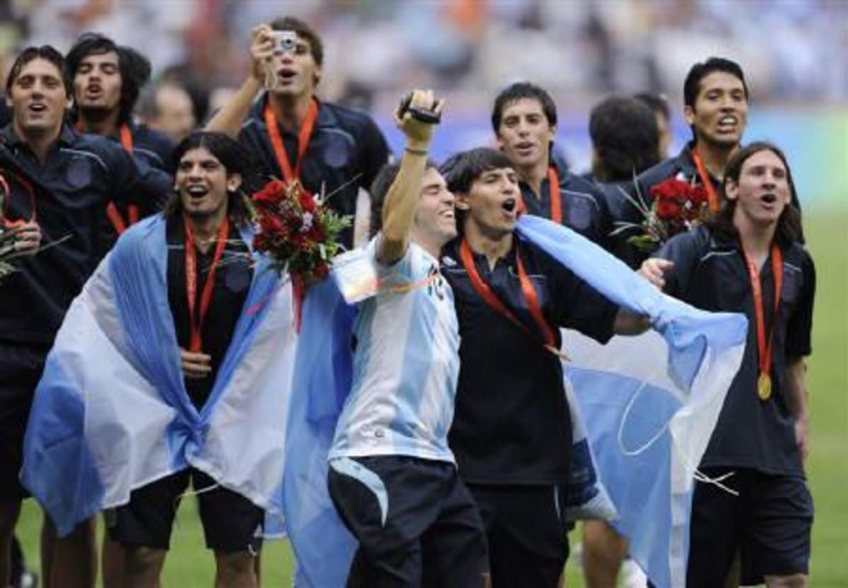 Argentina celebrates winning the gold medal at the 2008 Summer Olympics. The South American nation won gold for the second straight Olympic tournament in football.