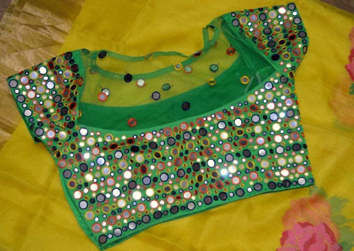 bright green multi coloured blouse that would look great at mehendi ceremony or holud ceremony with lehenga or net saree