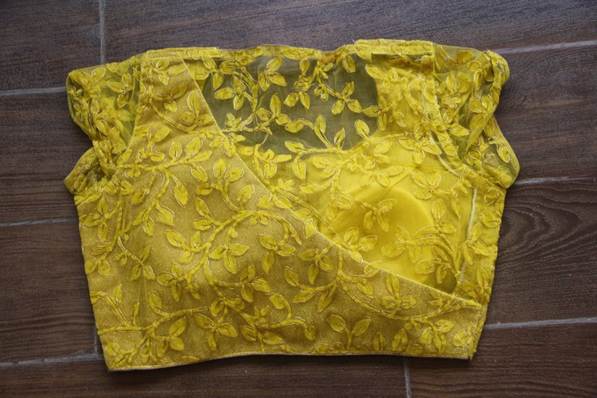 yellow blouse with matching yellow design for sari