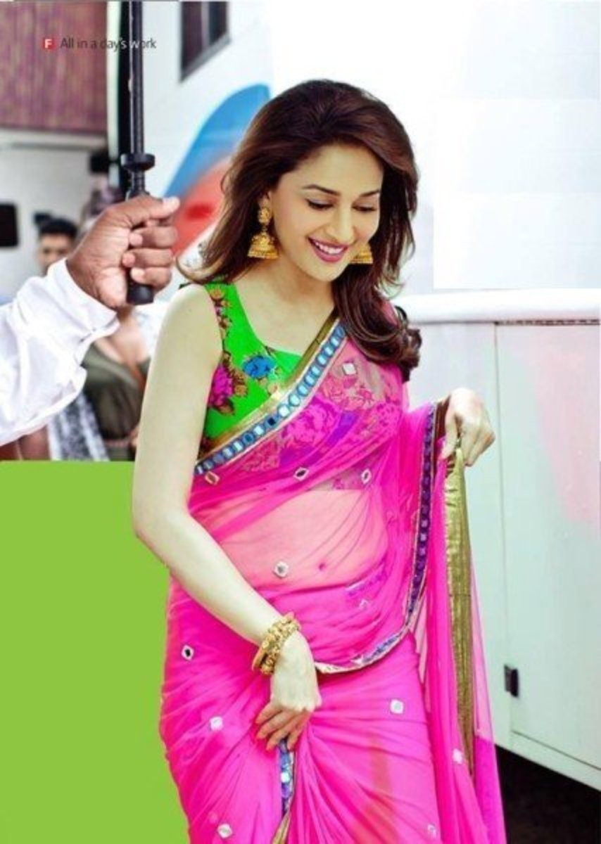 Even Madhuri Dixit wore the green floral printed blouse which is the latest in fashion for saree.