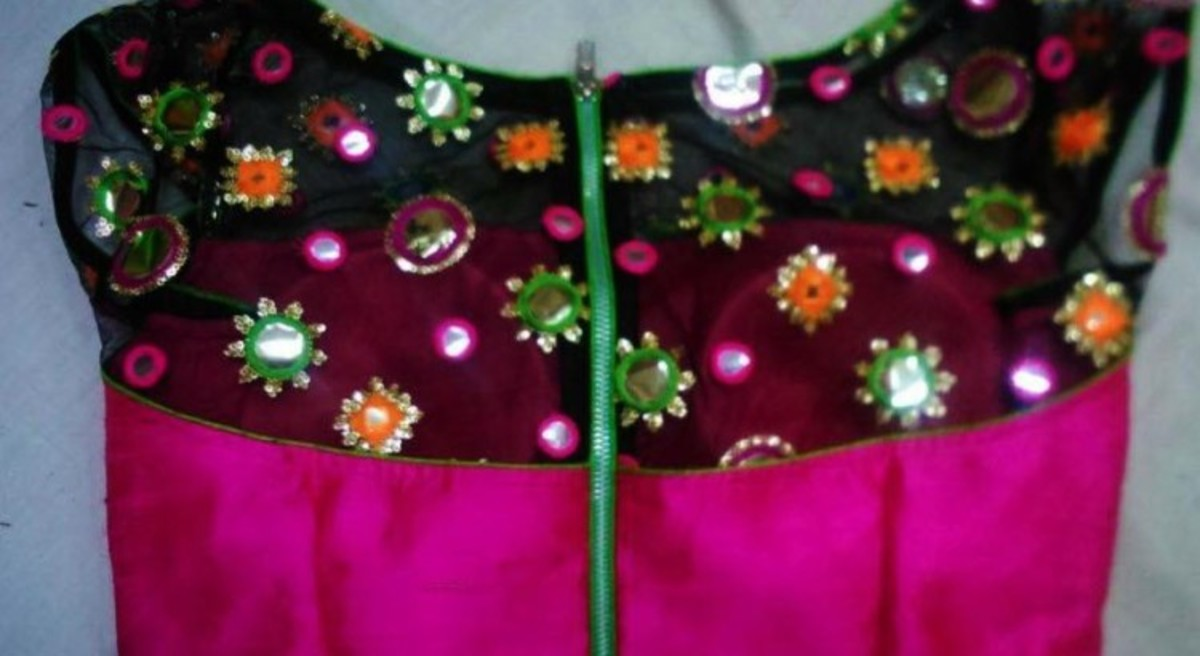 pink and black blouse with zipper opening