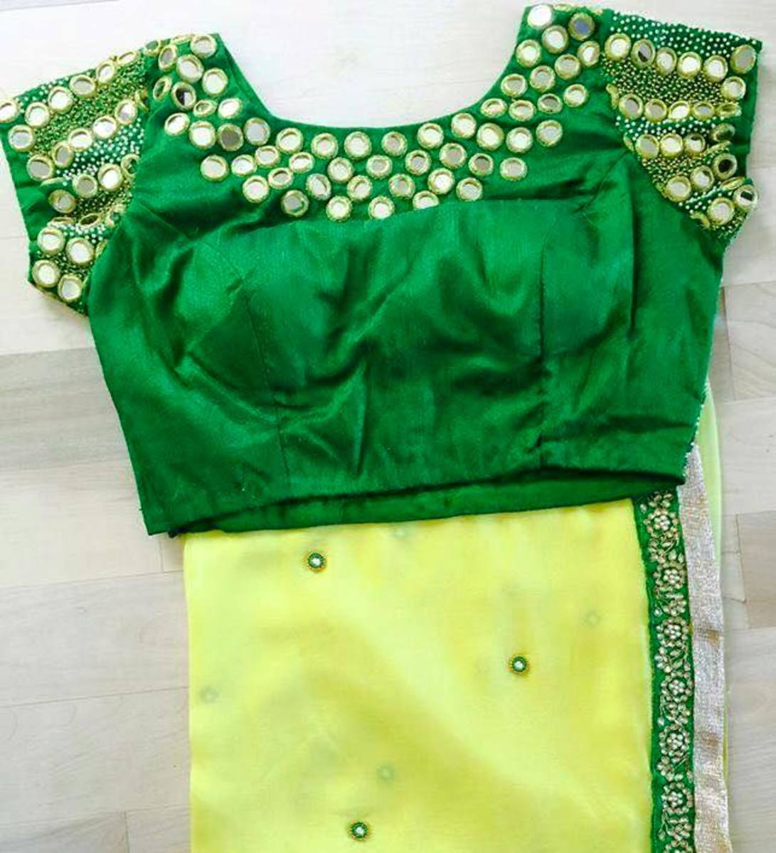 green blouse with mirror designing paired with lime yellow georgette saree with green thin border