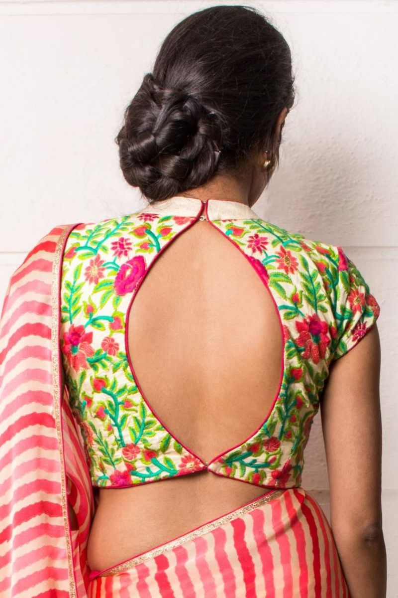Back design of floral blouse with eye shaped backless opening