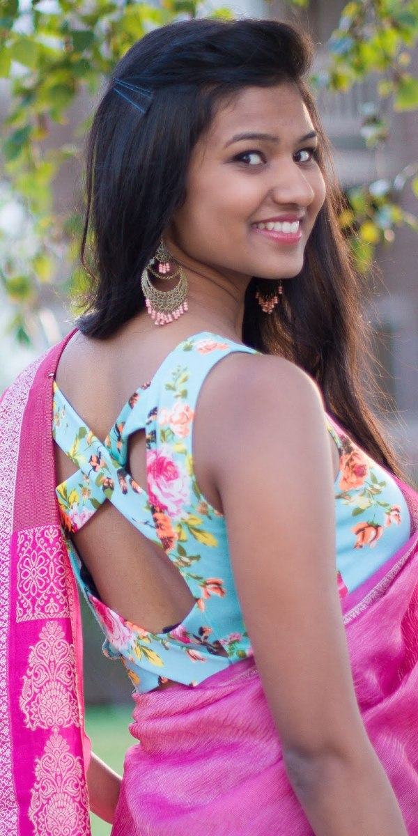 Very girly and feminine floral printed blouse with crossed backless blouse with pink saree