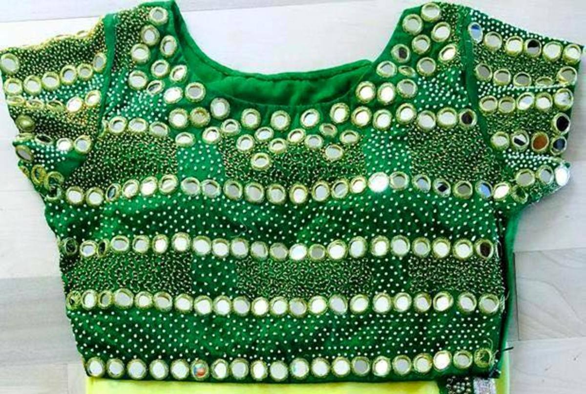 green blouse front side with mirror embellishment