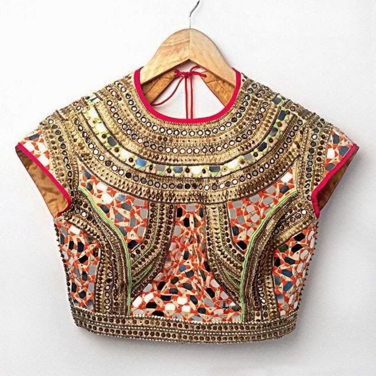 Party blouse with all over heavy mirror work which is perfect for any transparent chiffon or net saree