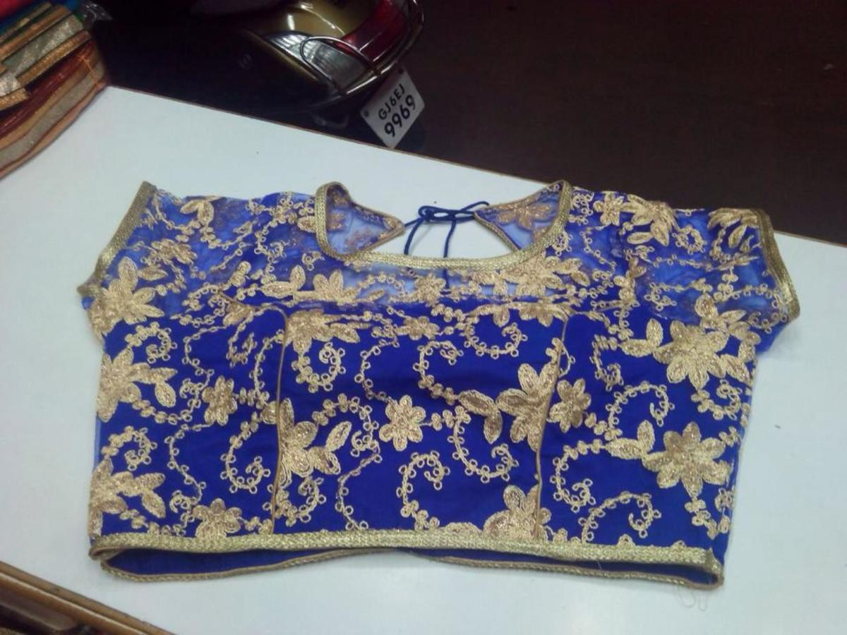 Electric blouse blouse with golden all over embroidery perfect for transparent net saree