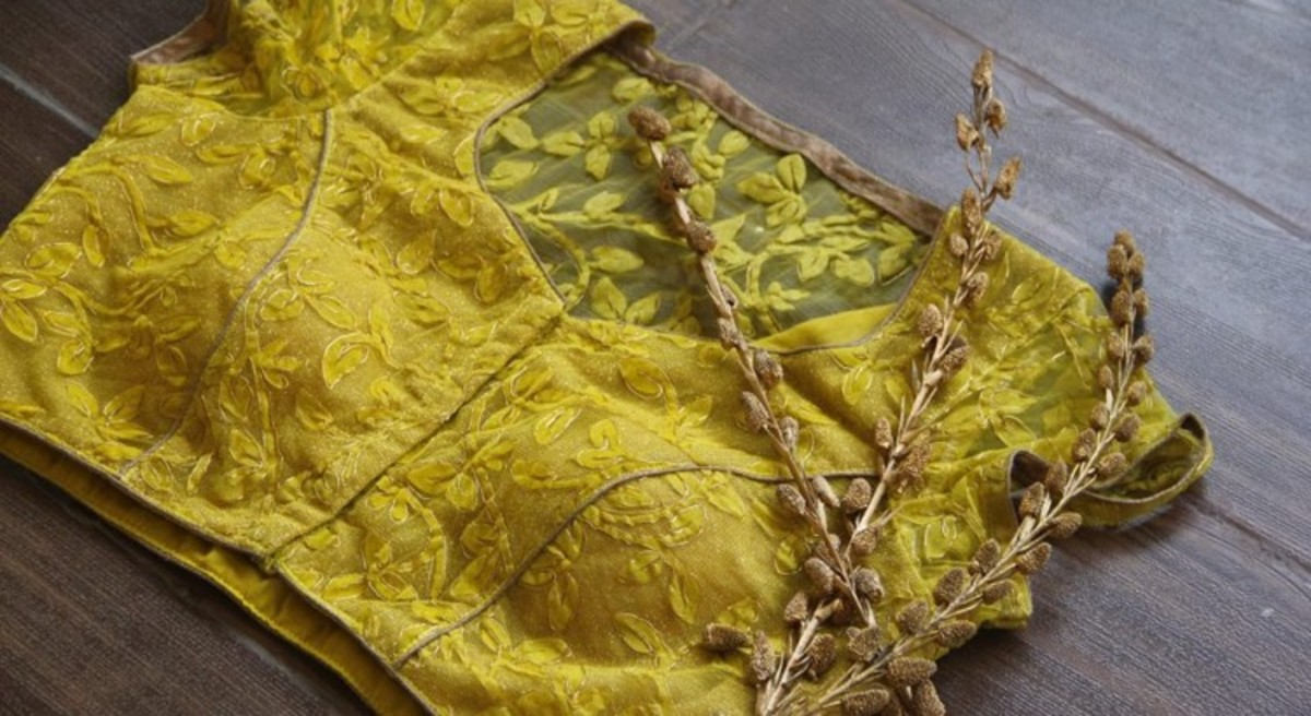 Front and back picture of all over embroidered blouse for saree in yellow colour