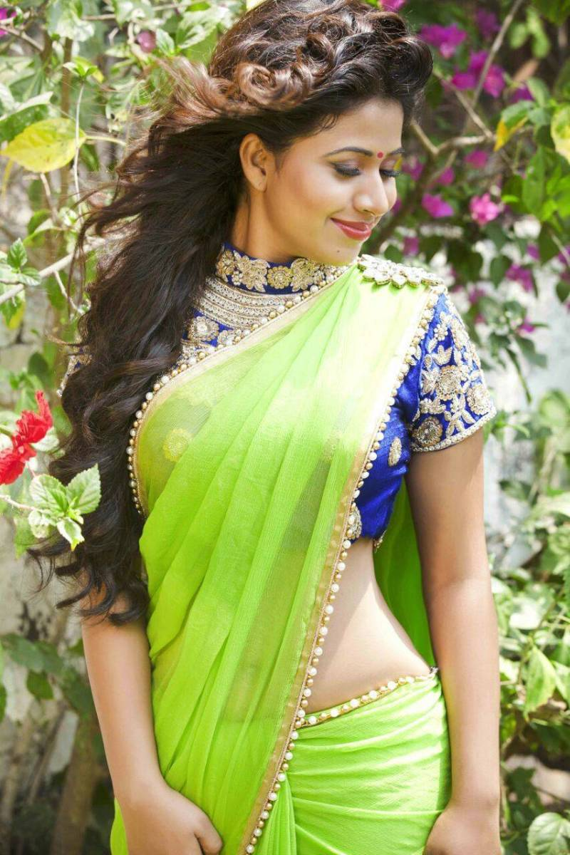 High neck blouse with heavy design with green saree