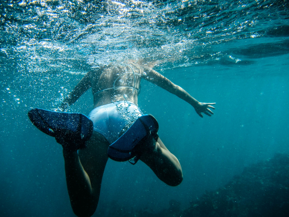 You wouldn't be able to get this perspective of the swimmer from above the water.