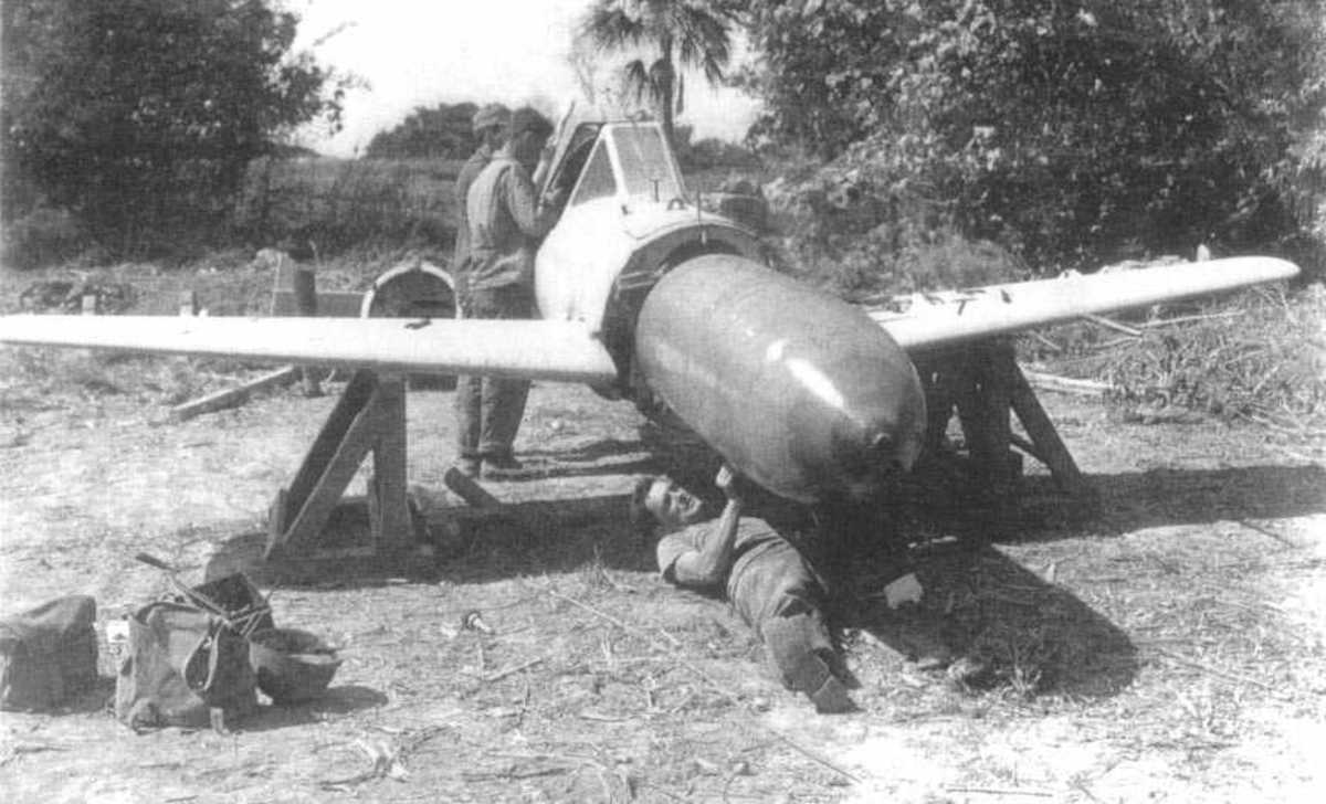 The 2,646 pound warhead of the Ohka, Allied soldiers dis-arming one after the war.