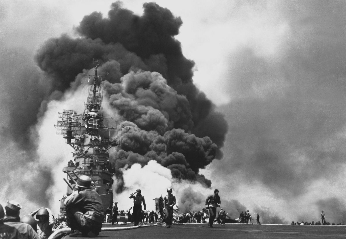The aircraft carrier Bunker Hill hit by a kamikaze during the Battle of Okinawa.