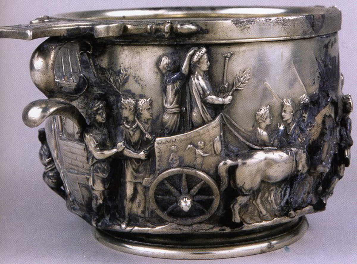 "Tiberius in Triumph. Kleiner, A History of Roman Art , p. 105: ""The Tiberius cup shows on one side the emperor-to-be riding in a triumphal quadriga holding a laurel branch and an eagle-tipped scepter'"