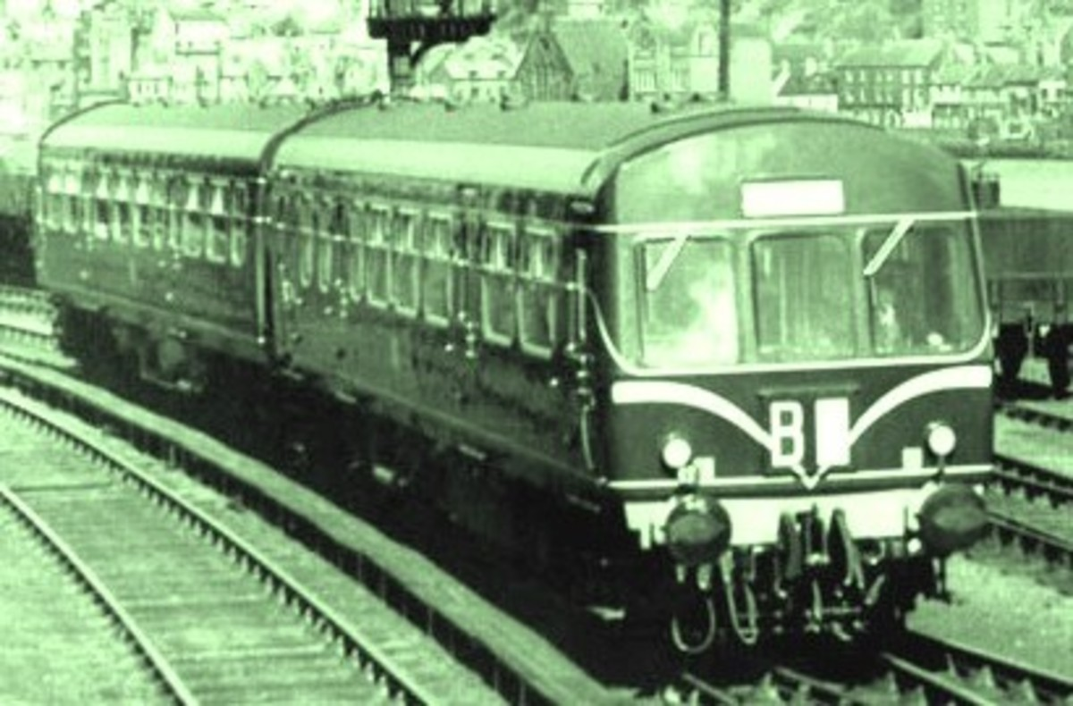An early Metro-Cammell diesel multiple unit with 'speed whiskers' leaves Whitby Town station for the Esk Valley. Livery was initially Brunswick Green lined in cream, later with yellow panels around the route describer (code) box below the windscreen