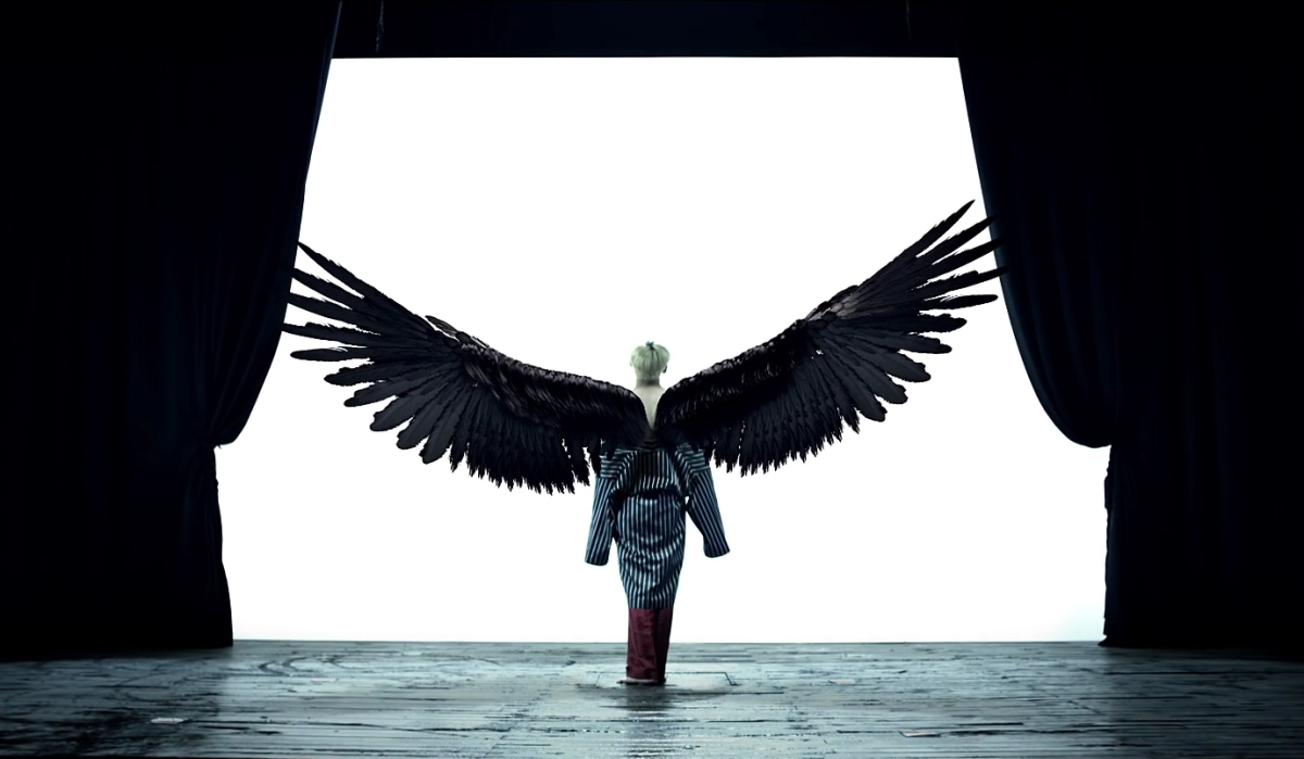 V spreading his full-grown wings.