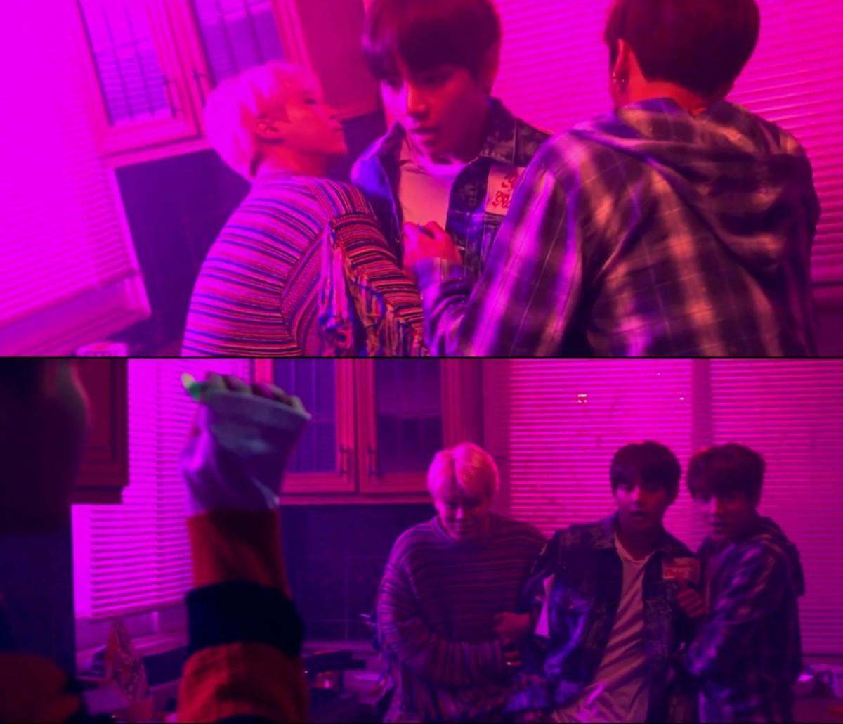 Jimin and Jungkook holding V as J-Hope aims a picado dart at him.