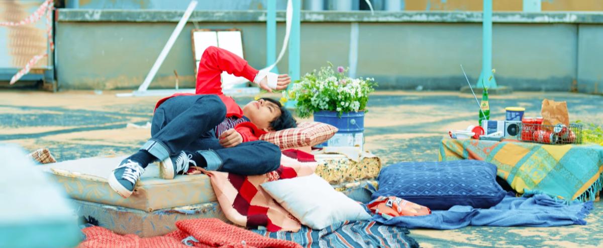 "V lying on the mattress similar to ""Prologue""."