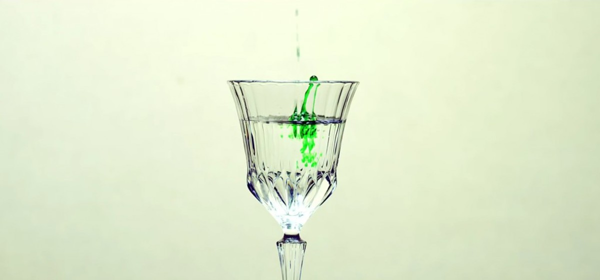 The green drop that falls into a glass cup at 1:42.