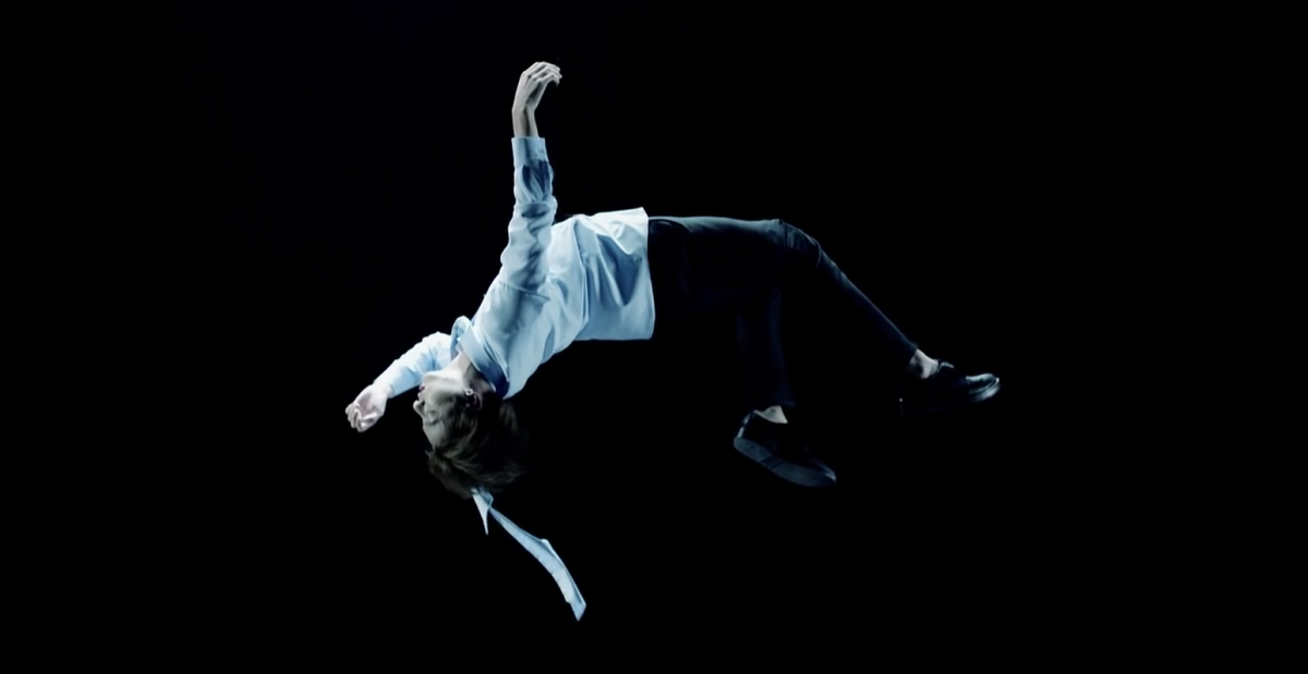 Jungkook floating in the air.