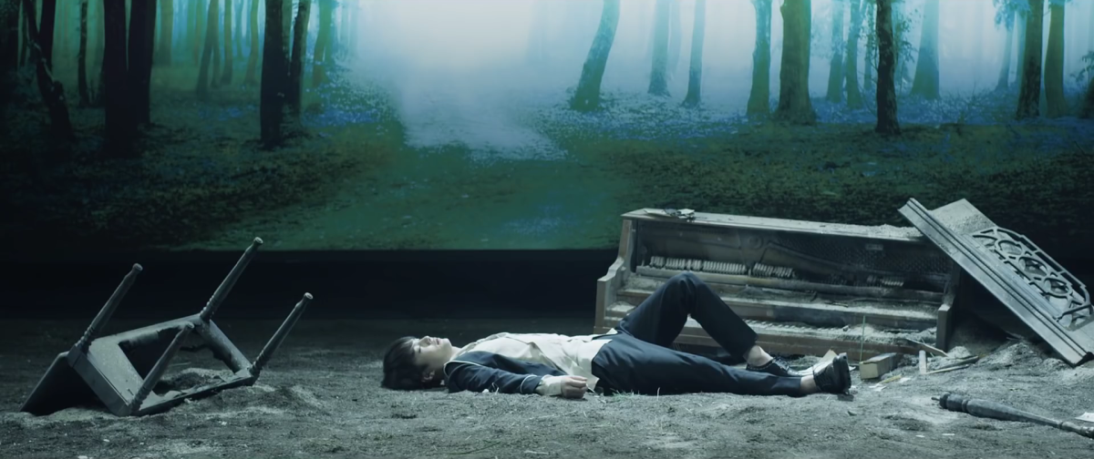 Suga lying on the ground.