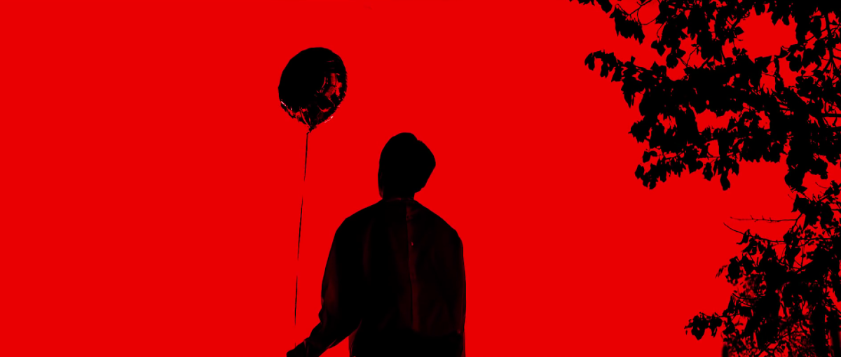 Jin holding a balloon.
