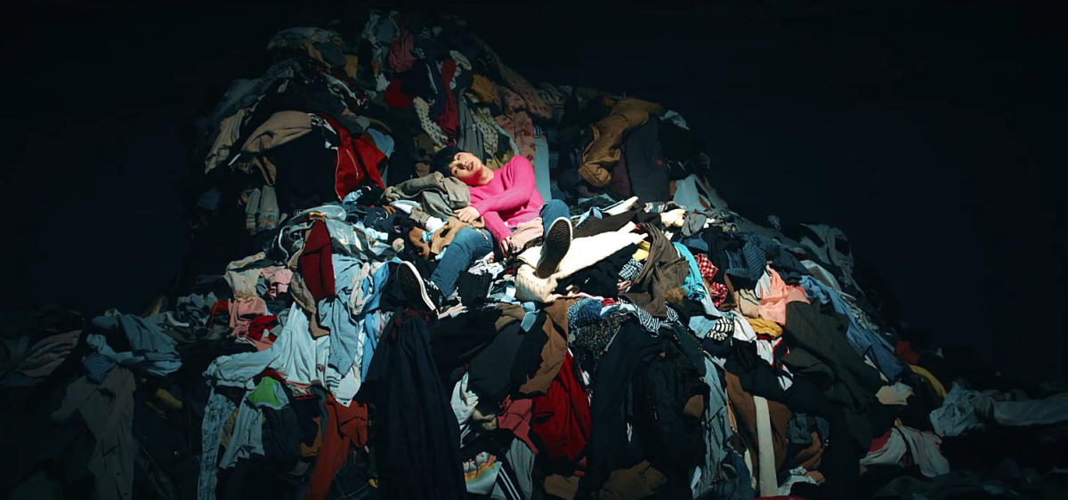 Suga on the pile of clothes.
