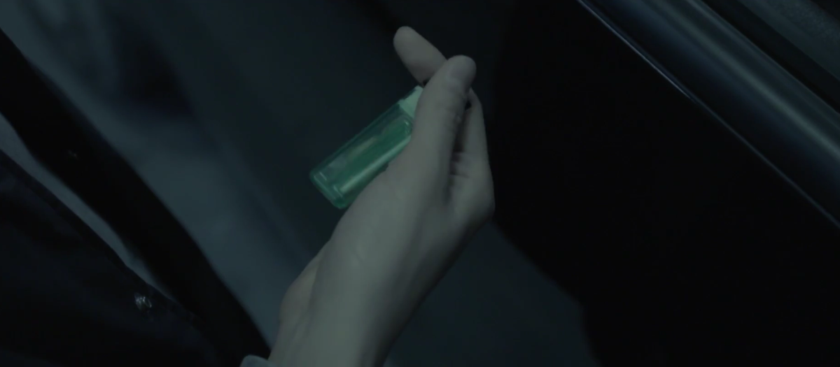 Jin giving the lighter to RM.