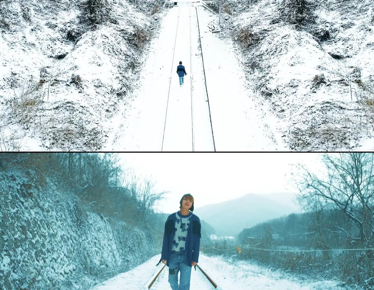 V walking down the iron rails.