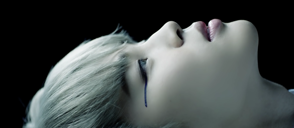 Jimin crying a blue tear.