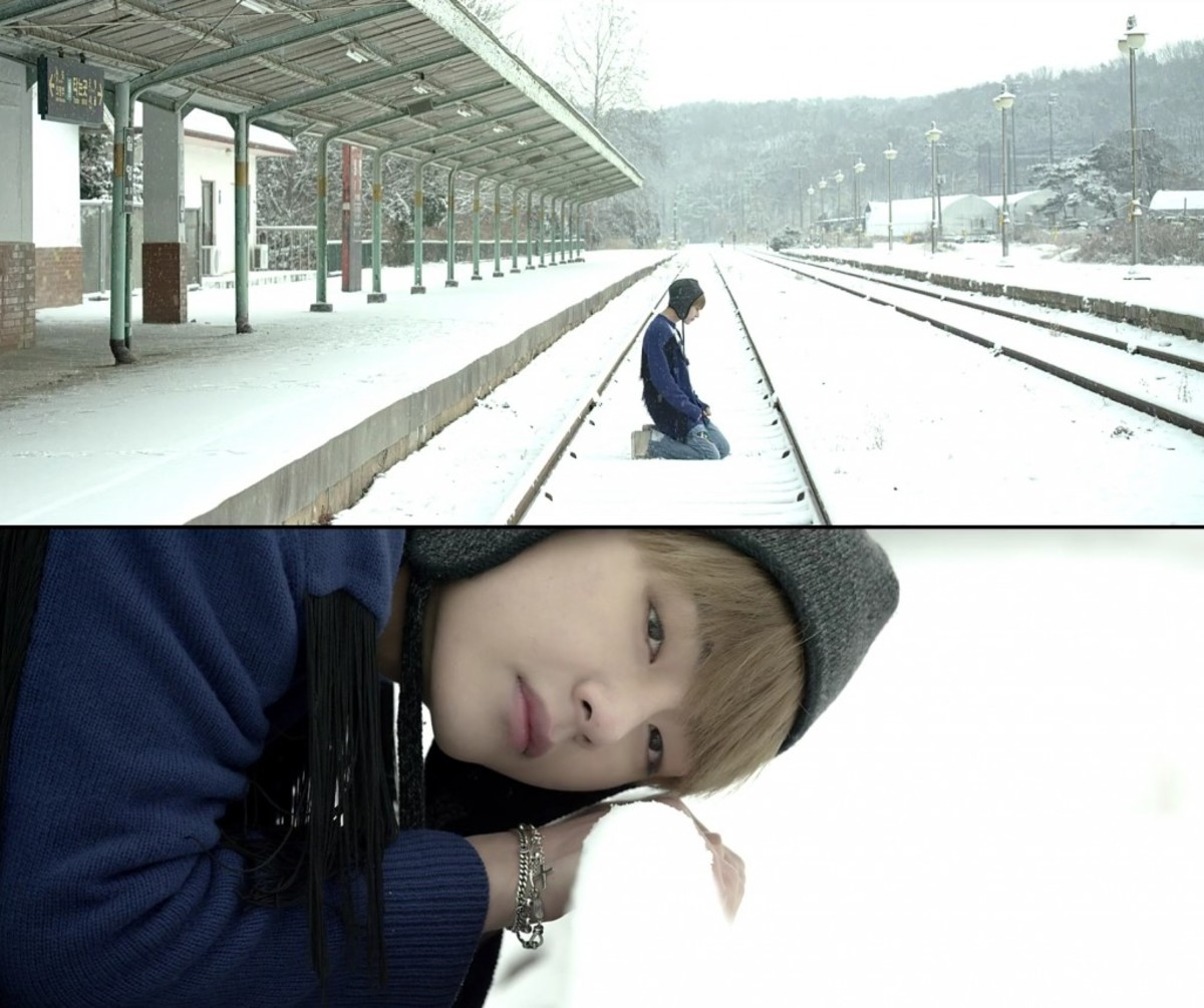V putting his head on the rails, trying to commit suicide.
