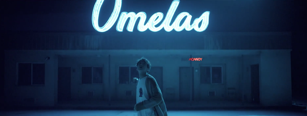 "Jungkook in front of Omelas and ""NO V"" flickering on the sign."