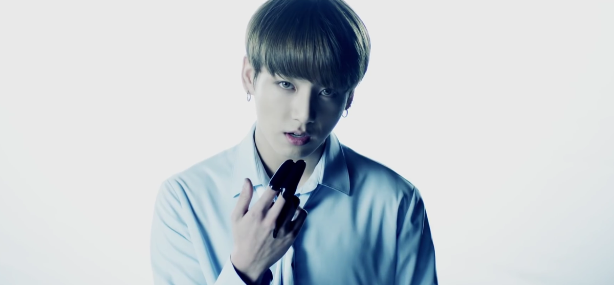 Jungkook with black ink on his fingers.