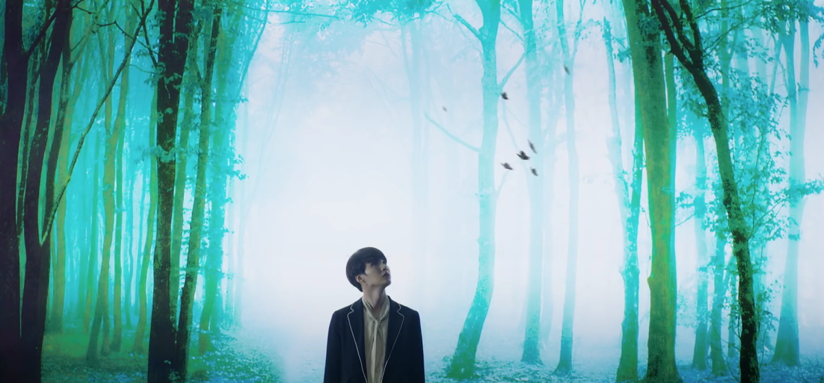 Suga watching seven butterflies flying above him.