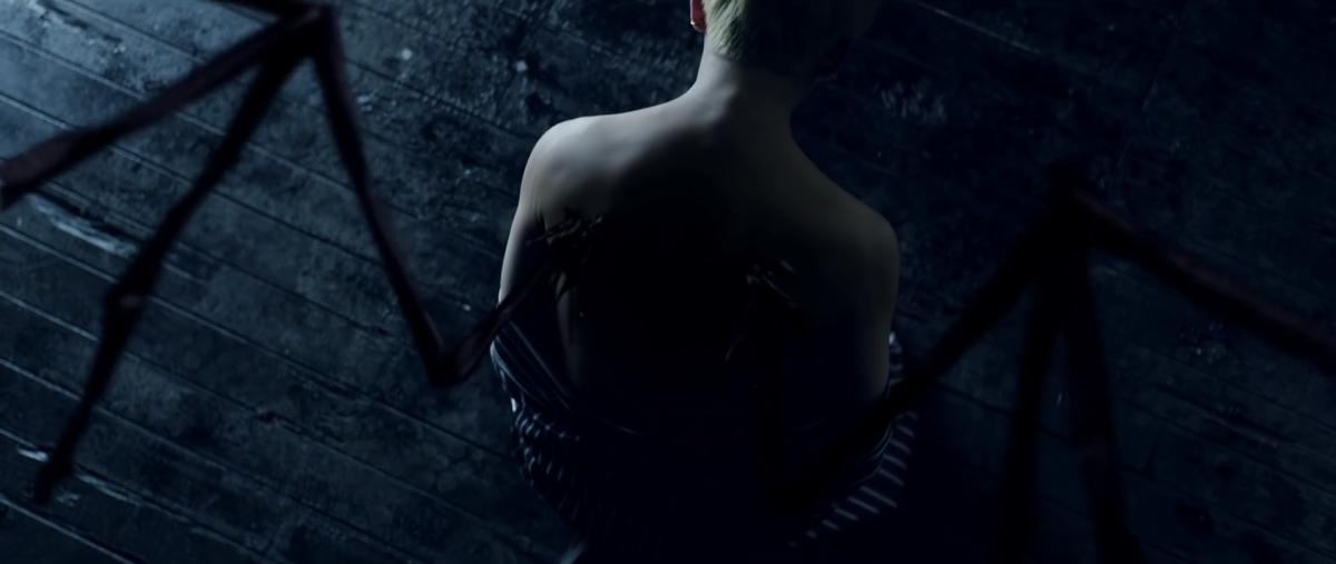 Black wings growing on V's back.