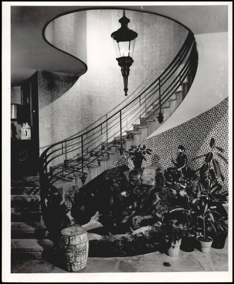 Water feature and staircase leading up to the second floor
