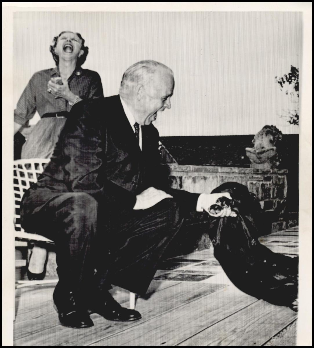 Sen Kerr was trying to get the dog to perform like he hopes it will when President Kennedy visits the Kerr home near Poteau.