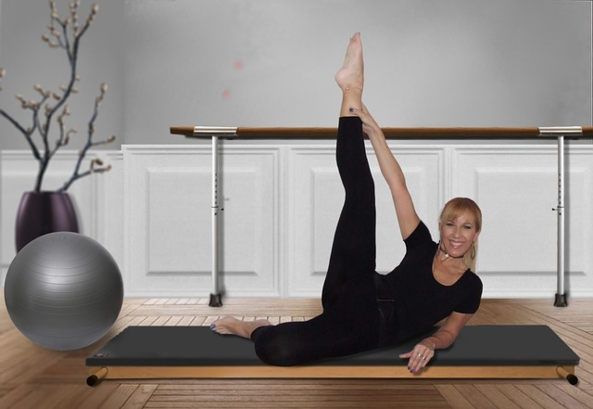A woman doing her leg stretches as part of her exercise routine.