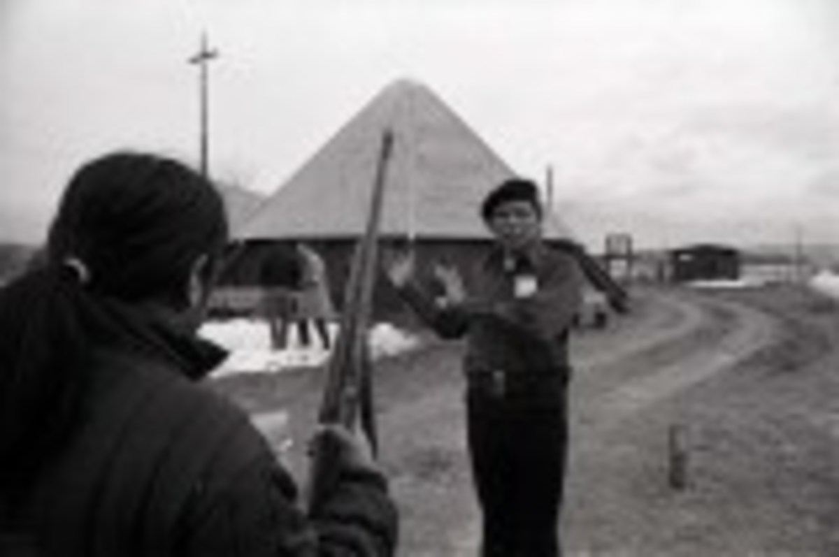 Dennis Banks speaks with fellow supporters during the occupation.