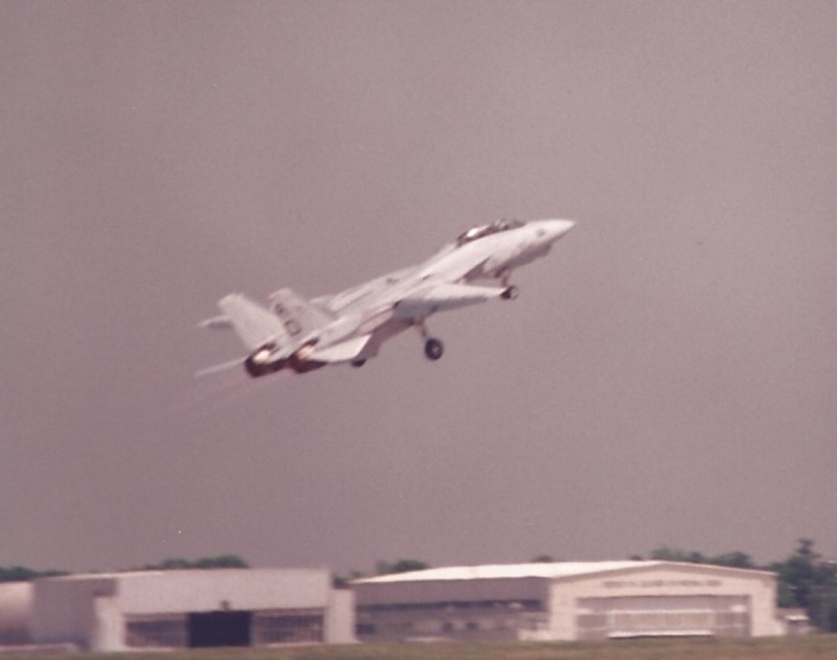 An F-14 taking off.