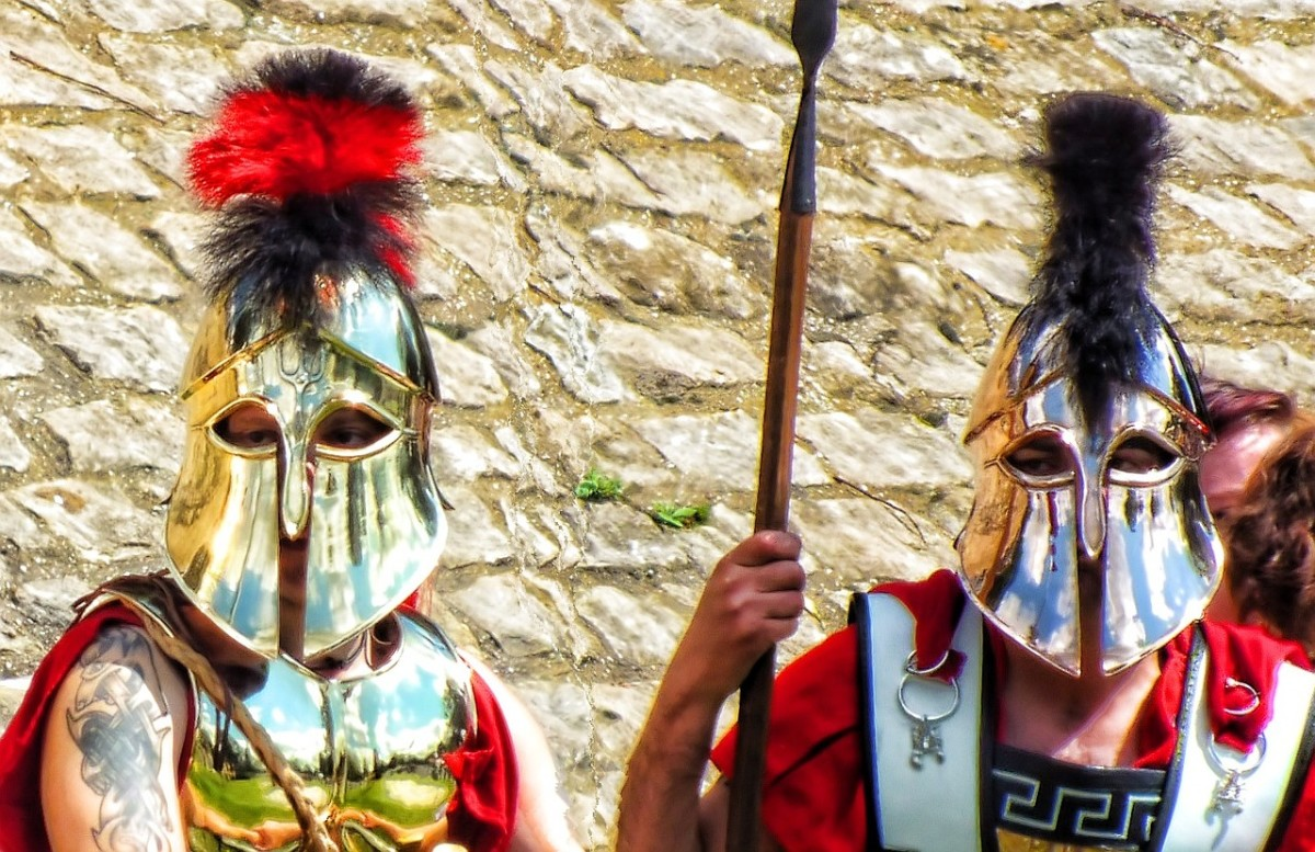 Roman-Grecian soldiers wearing their metal masks for protection against sharp blades during combat.