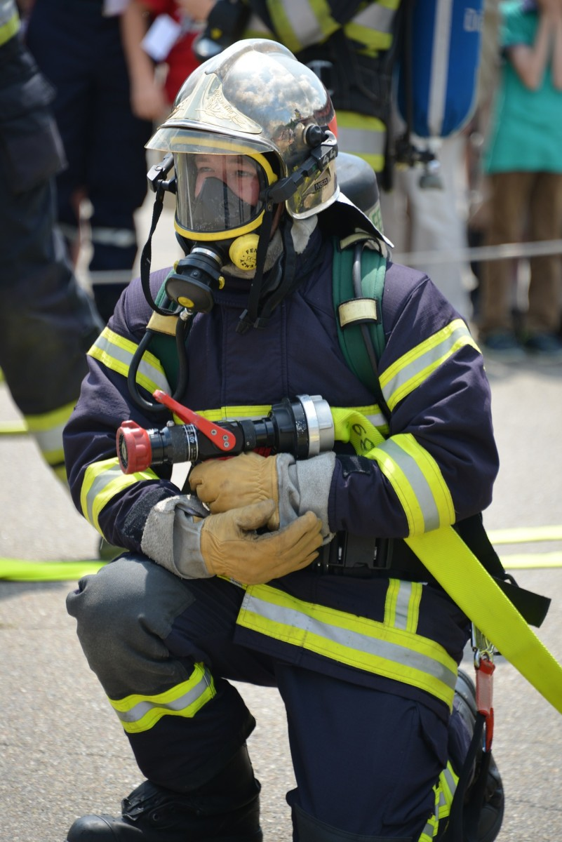 Many fire fighters wear gas masks, helmet, and other protective gear for protection from intense fire flames, heat, and burning chemicals.