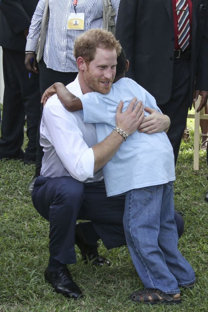 Prince Harry hugs and is hugged