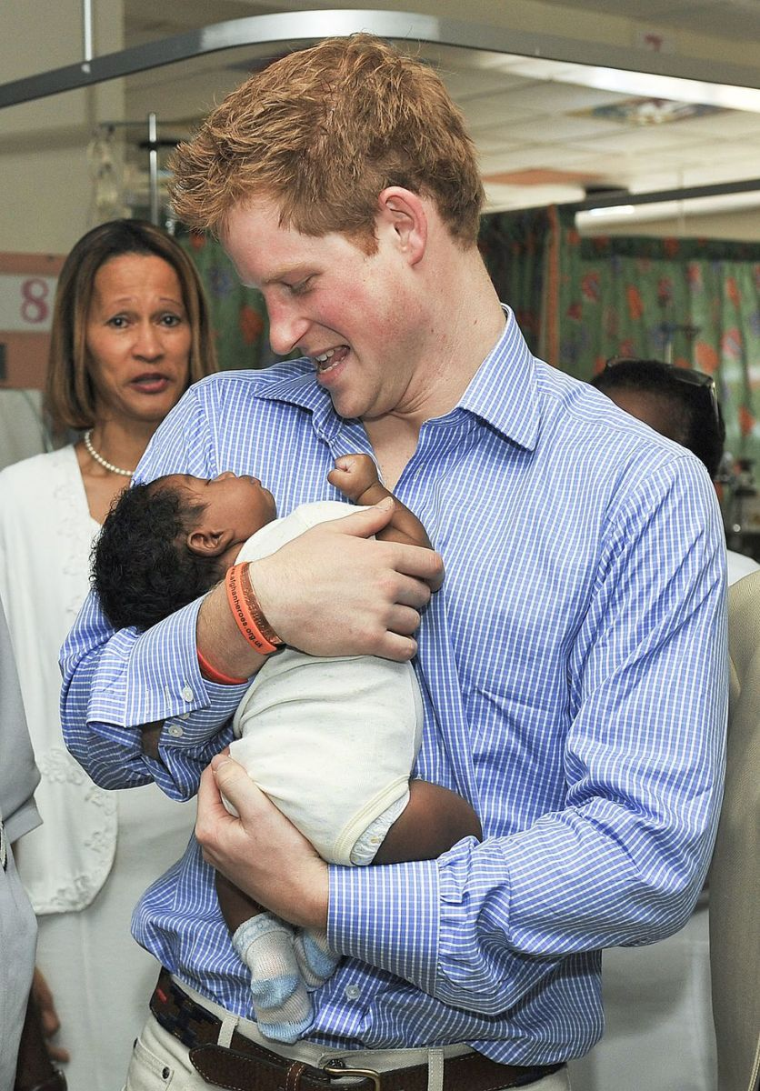 Prince Harry with a newborn baby in 2010