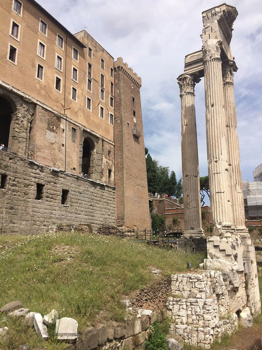 The Tabularium, behind the corner columns of the Temple of Vespasian and Titus.