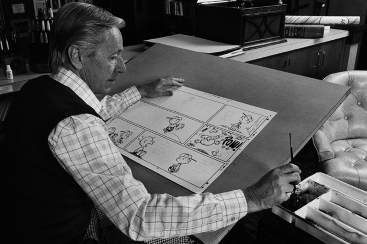 Charles Schulz drawing Peanuts comic
