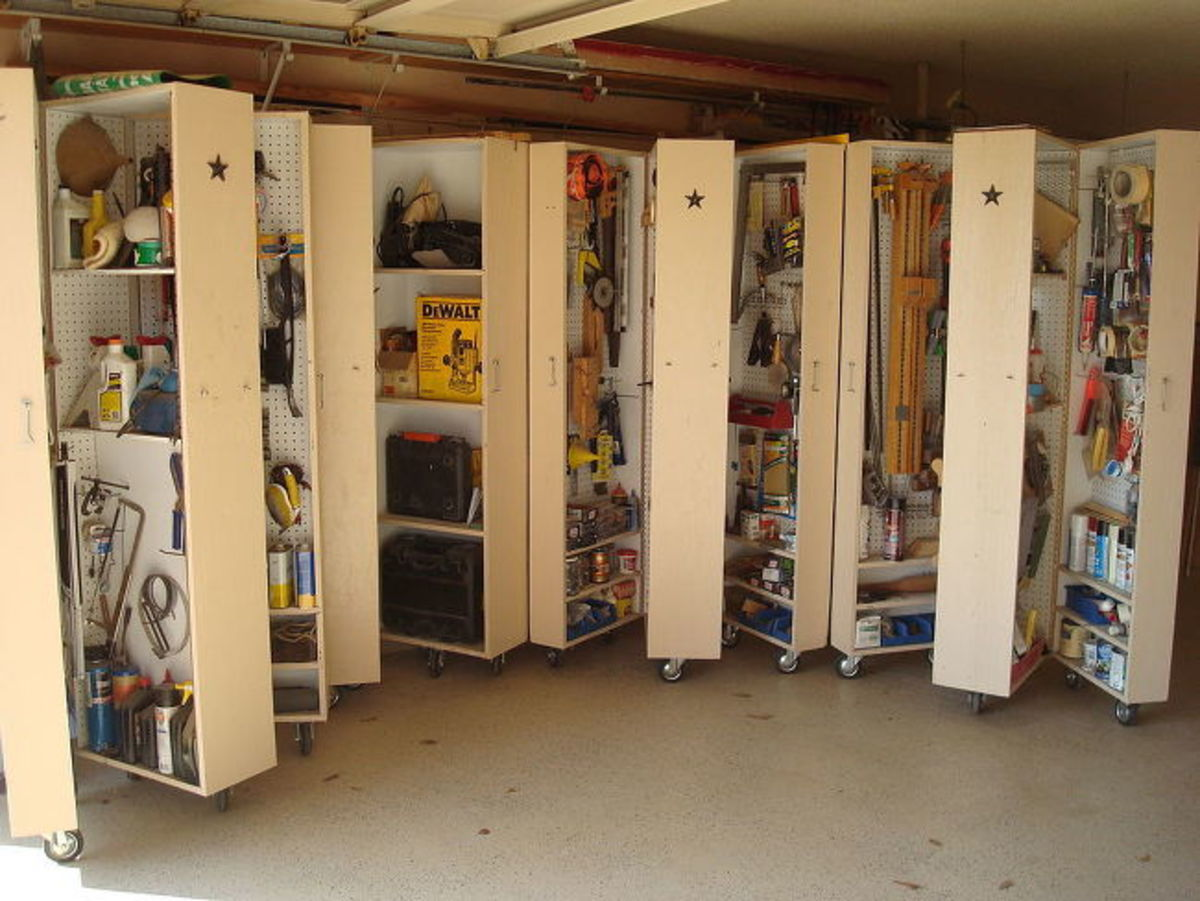 All four cabinets opened to show how much storage is available.  Casters are installed and ready to roll into position.