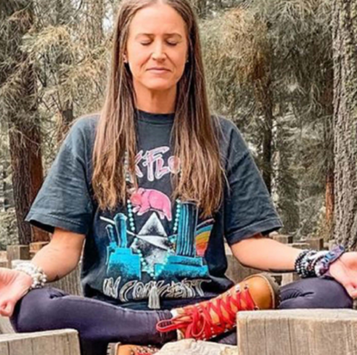 Holly Courtier, who vanished October 6, 2020, meditating in the woods during a previous hike.