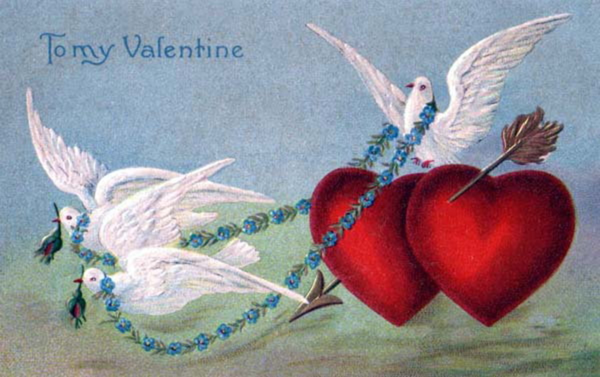 Victorian valentine card with two red hearts and three white doves