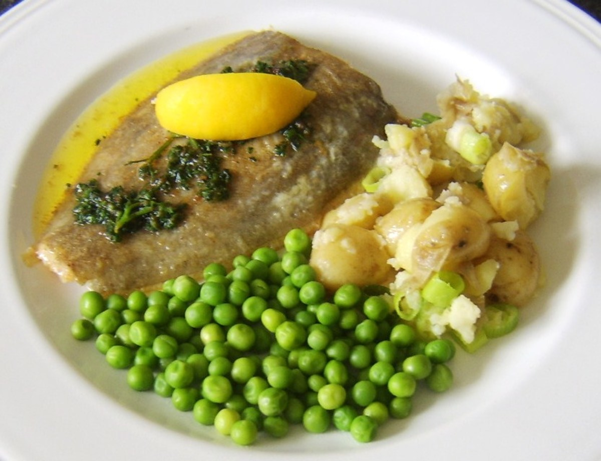 Pan fried lemon sole is cook in butter and served with a butter, parsley and lemon sauce